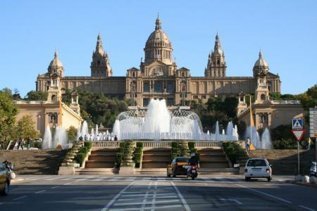 View at Catalonian national museum MNAC and Magic Fountain on Montjuic mountain in evening in Barcelona