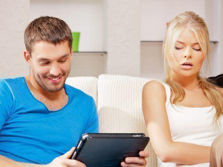 bright picture of couple with tablet PC (focus on man)